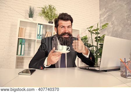Best Tea. Realtor Give Thumbs Up With Tea Cup. Lawyer Drink Tea In Office. Bearded Man Enjoy Tea Bre