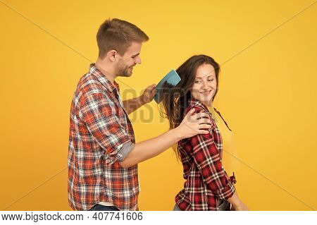 Hair Care At Home. Helping With Hairstyle. Couple Having Fun With Big Comb. Combing And Brushing Hai