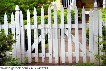 Country Style, White, Picket Fence Front Yard In Memphis, Tennessee.  Fence Is Wooden And Rustic And