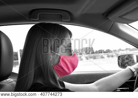 Black And White Image Has Color Pop Of Pink.  Young Woman Drives In Memphis With Her Pink, Cloth Fac