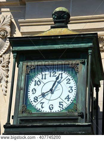 Copper, Town Clock Has Turned Green Over The Years.  Beautiful Clock With Green Stained Glass Face A