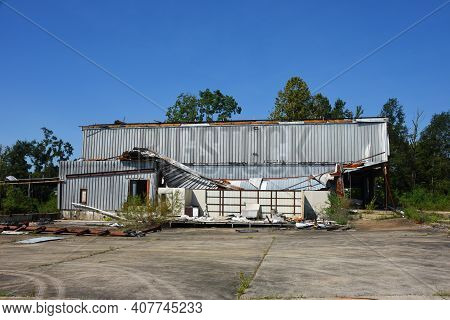 Business In Ruston, Louisiana, Is Damaged From Tornado Or Wind Storm.  Tin Roof Is Collapsed And Sid
