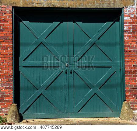 Double Green Doors With Padlock