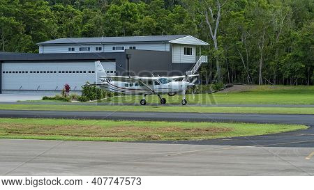 Airlie Beach, Queensland, Australia - February 2021: A Light Aircraft Filled With Skydivers Taxiing