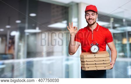 Courier Is Punctual To Deliver Quickly Pizzas At Home