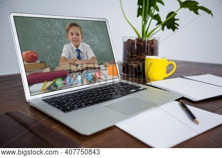 Caucasian schoolboy learning displayed on laptop screen during video call. Online education staying at home in self isolation during quarantine lockdown.