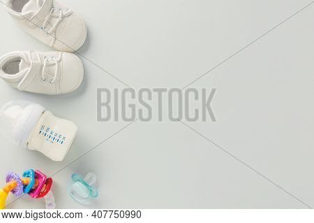 Baby Care Or Baby Shower Concept. Flat Lay. Newborn Or Baby Cloth, Toys, Nipple And Bottle For Feedi