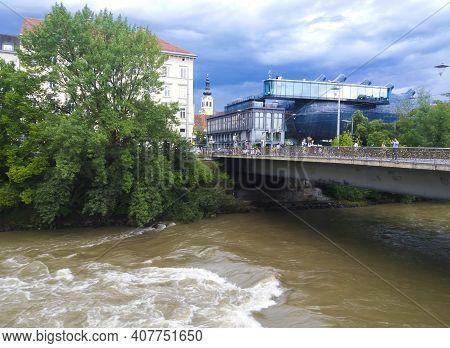 Graz,austria-17.08.2020:mur River, Love Bridge And Kunsthaus Graz, The Modern Art Museum For Contemp