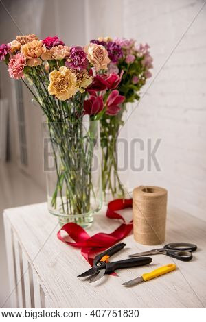 Florist's Workplace. Tools And Flowers Before Starting Work On The Table. Floristic's Knife, Scissor