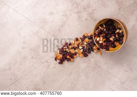 View Of A Bowl With Almonds And Blueberries, They Fall Out Of The Bowl On The Table A Very Artistic