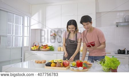 Couple Young Asian Cutting Vegetables Together Enjoying Cooking And Smile Enjoy Life Together In Hom