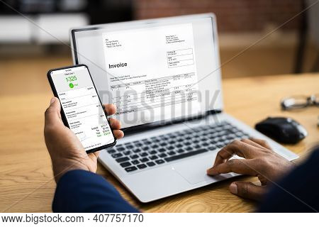African American Using Accounting Invoice Budget App On Computer