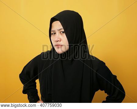 Portrait Of Cynical Asian Muslim Woman With Suspicious Expression Looking And Starring, Mistrust Mis