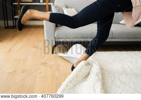 Falldown Hazard. Clumsy Woman Stumbled On Rug