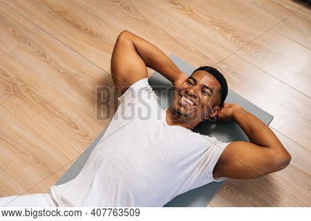 Top View Of Fit Cheerful African-american Man Practicing Abs Crunches, Training Abdominal Muscles On