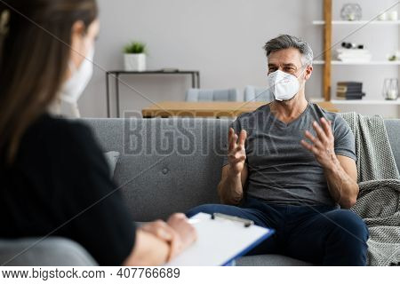 Psychiatrist Or Psychology Psychologist With Clipboard And Face Mask