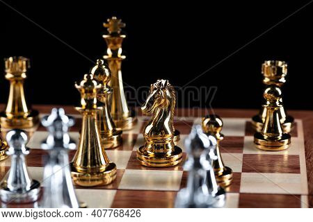 Gold And Silver Chess Figures Standing On Chessboard. Intellectual And Tactic Game. Strategy Plannin