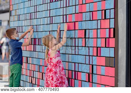 Dnepr, Ukraine- September 12, 2020: Happy Excited Kids Having Fun With Pixels On Big Bright Wall, Vi