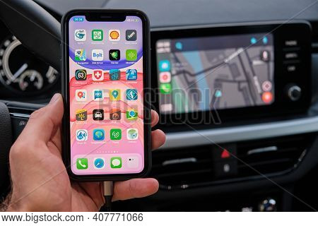 Navigation App On The Screen Of Smart Phone In Mans Hand On The Background Of Car Dashboard Screen W