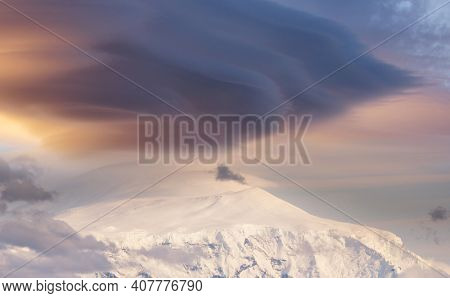 Unusual storm clouds over the mountain peak. Wrangell-St. Elias National Park and Preserve, Alaska.