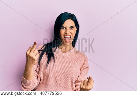 Young caucasian woman wearing casual clothes showing middle finger doing fuck you bad expression, provocation and rude attitude. screaming excited