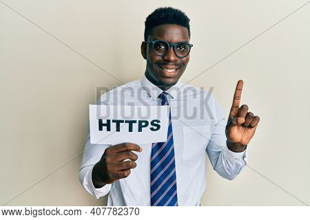 Handsome black man holding https privacy url smiling with an idea or question pointing finger with happy face, number one