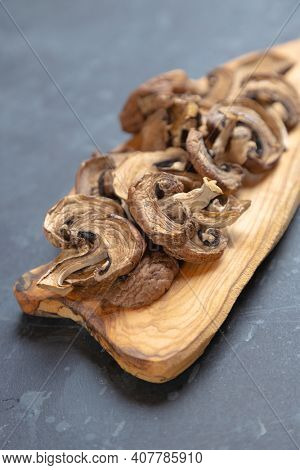 Dried button mushrooms, healthy food ingredient used as spice in cooking
