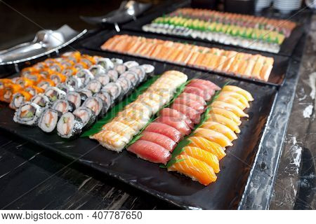 A Lot Of Sushi Rolls And Maki On The Buffet Line. Japan Traditional Food.