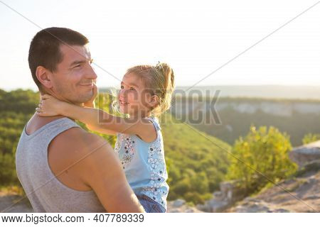The Father And Daughter Hug Tightly, The Girl Holds The Father By The Neck, The Father - In His Arms