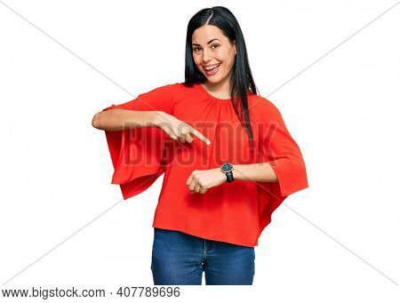 Beautiful young woman wearing casual clothes in hurry pointing to watch time, impatience, upset and angry for deadline delay
