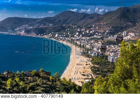 Alanya , Turkey- October 20, 2020:View on Cleopatra's beach and cable car to Castle on suny day Alanya. Turkey.