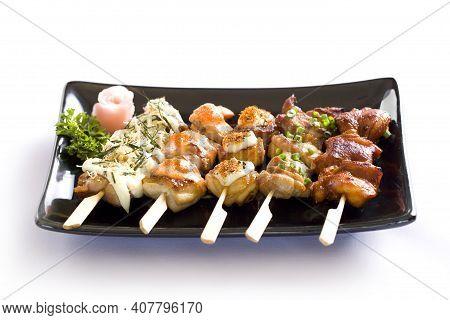 Various Kind Of Grilling Kushiyaki Or Meat Skewers On White Background. Japanese Style Skewered Food