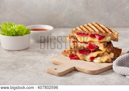 grilled salami and cheese sandwich