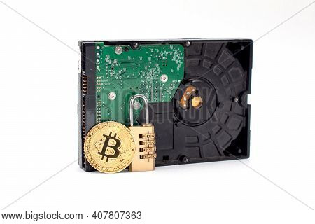 Coin Of Bitcoin On Hard Disc Drive. Combination Padlock With Coin Of Bitcoin And Hard Disc Drive