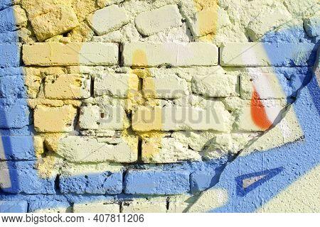 Damaged Brick Wall With Graffiti. Graffiti On The Wall.