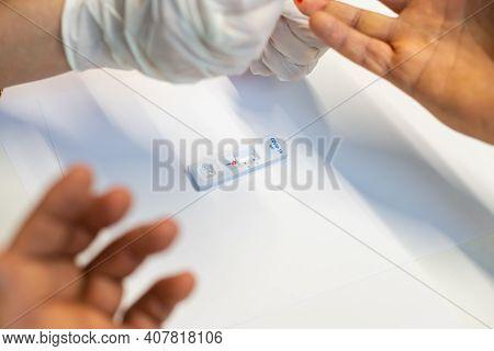 Medical Technician Ems Doctor Taking Finger Prick Prp Patient Blood Sample Using Pipette, Coronaviru