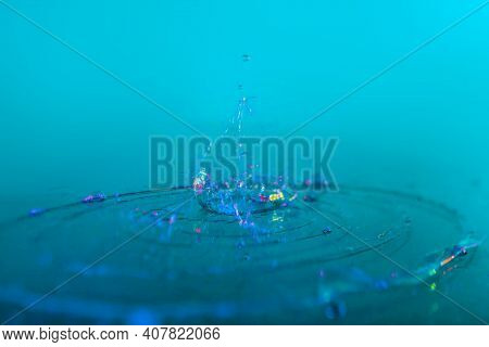 Water Splash On Azure Color Background. High Quality Photo