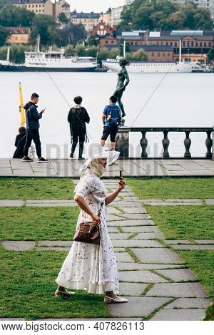 Stockholm, Sweden - August 8, 2019: Asian Tourist Woman Is Making A Selfie In Waterfront Of Stockhol