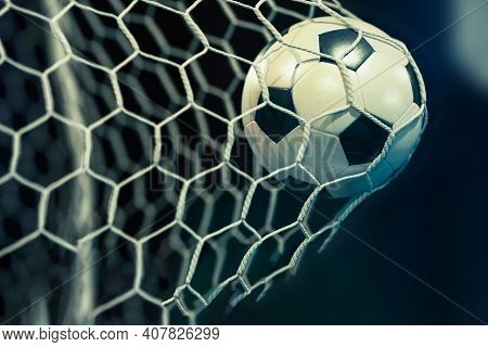 Soccer Ball In The Net, The Moment A Goal Is Scored. High Quality Photo