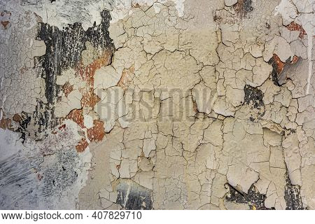Old Weathered Painted Multicolored Plastered Peeled Wall Background. Cracked Flaked Shabby Wall With