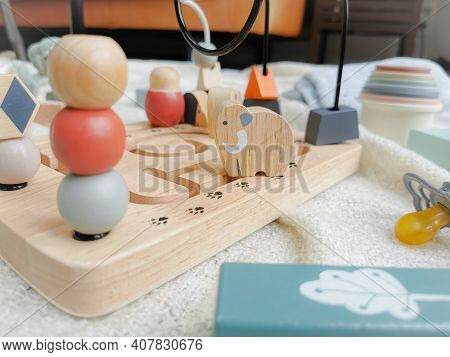 Gender Neutral Wooden Bead Toy In Soft Colors. Gender-neutral Parenting.