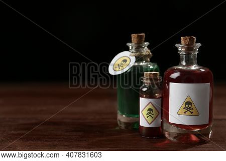 Bottles With Poisons On Wooden Table. Space For Text