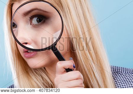 Ophthalmology, Spy Accessories, Eyesight Concept. Woman Looking Through Magnifying Glass Having Big