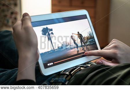 Man Watching Movie Stream. Person Using The Player Timeline To Rewind Or Skip Parts Of An Online Vid