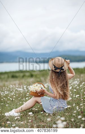Carefree Happy  Woman With Healthy Wavy Hair Having Fun Outdoor In Nature. Young Beautiful Woman Wit