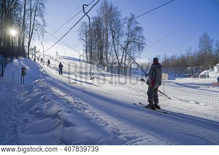 Moscow, Russia - February 2, 2021: Skiers On A Ski Lift On A Small Ski Slope On The Outskirts Of Mos