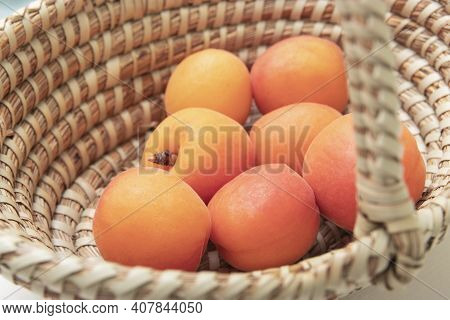 Ripe Apricots In Plate On The Table. Orange Apricots Fruits In Bowl. Juicy Apricots Nutrition.