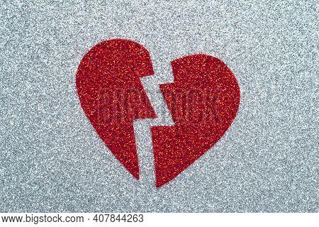 Broken Red Heart On Gray Glitter Paper, A Break Up Concept. Tinsel Applique. A Symbol Of Love, Valen