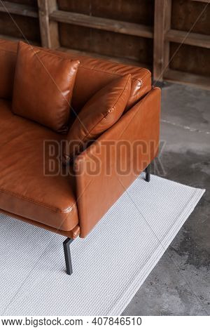 High Angle View Of Comfortable Sofa In Modern House Interior. Vertical View Of Leather Armchair In L