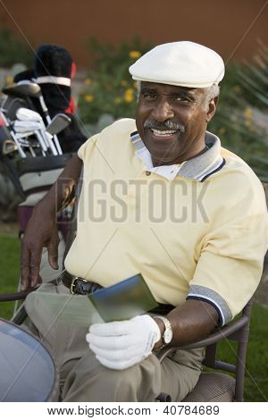 Smiling Golfer with Scorecard